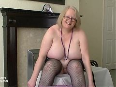 British busty Mature removes her lace purple panties
