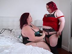 Big tits supersized BBW redheads have corset fun